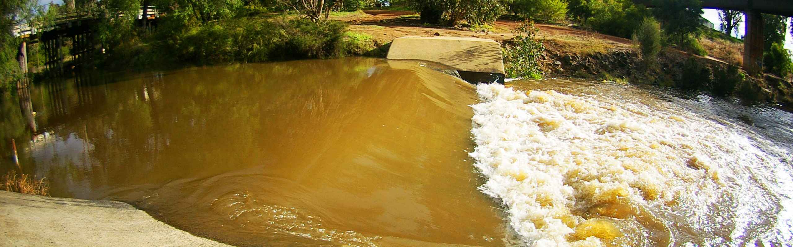 Photo: stream flowing over weir