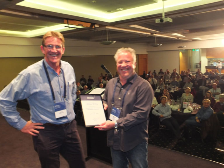 Simon Cruickshank presents Associate Fellow of AHA certificate to Michael Whiting