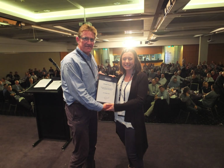 Simon Cruickshank presents Associate Fellow of AHA certificate to Krystal Hoult