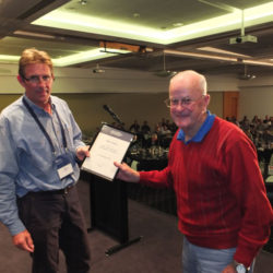 Simon Cruickshank presents Fellow of AHA certificate to Max Hayes