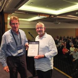 Simon Cruickshank presents Fellow of AHA certificate to Bill Barratt