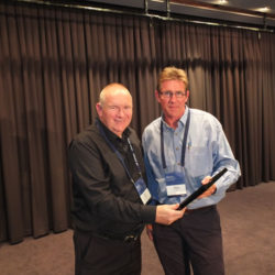 Simon Cruickshank presents Fellow with Life Membership to Bill Steen
