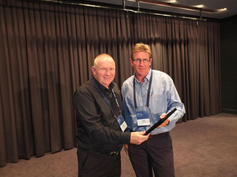 Simon Cruickshank presents Fellow with Life Membership to Bill Steen