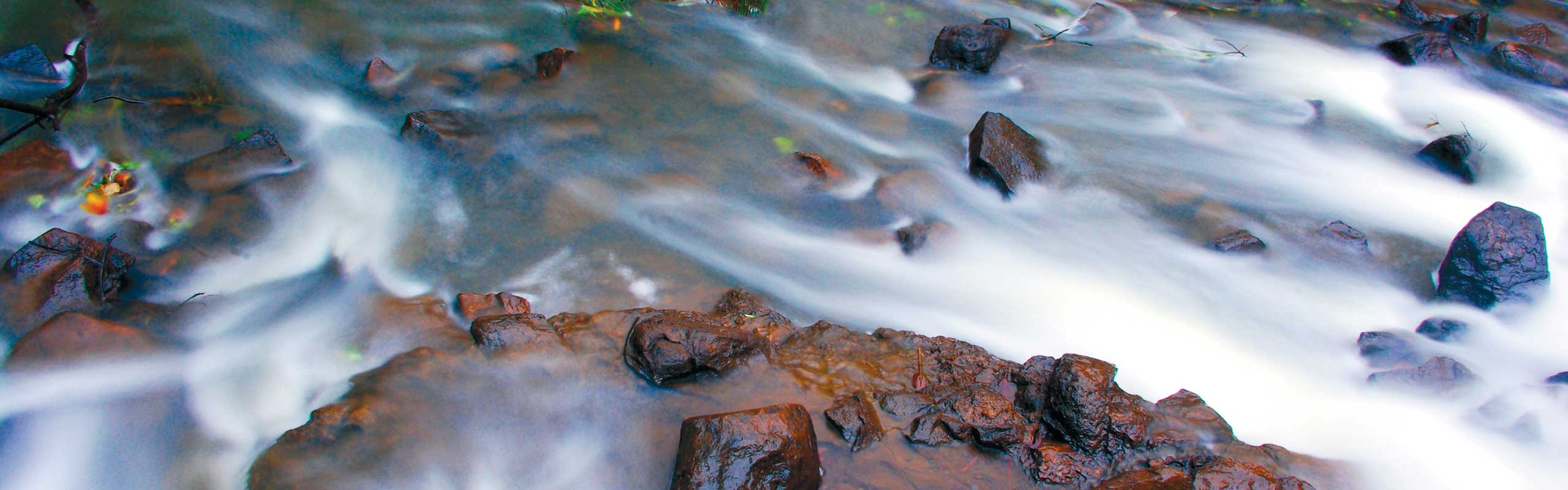 Photo: Water flowing over riffle
